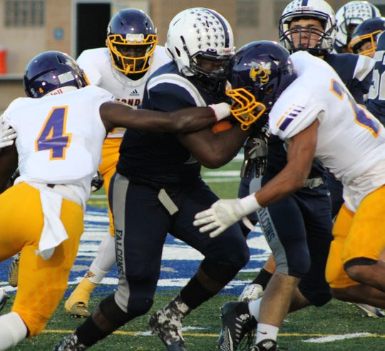 Farmington's senior running back Delmon Sewell powers through the Avondale defense.