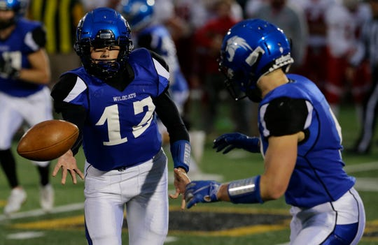 Oshkosh West's Jake Ketter pitches the ball to Blake Framke against Hortonville. Framke leads the team on the ground with 83 carries for 458 yards and five touchdowns.