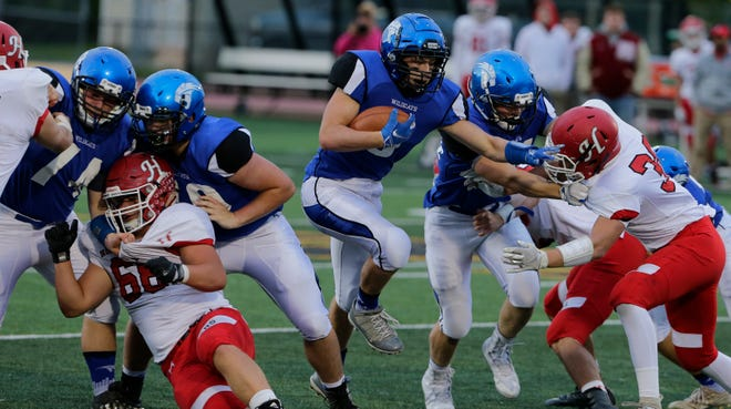Oshkosh West's Blake Framke runs up the middle in the second half of a Sept. 21 game against Hortonville.