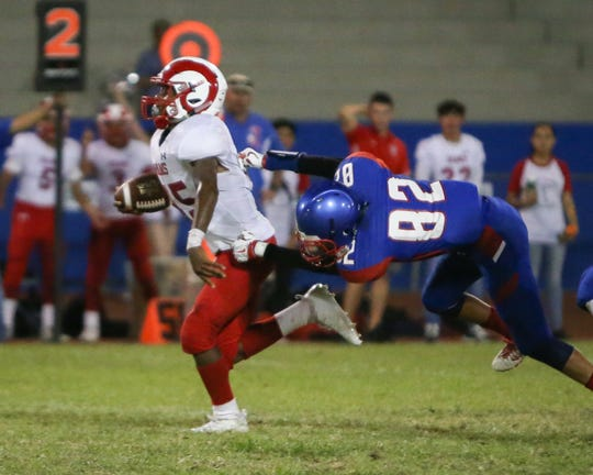 Joseph Sanchez (82) unable to stop Manny Ridge resulting Desert Mirage's 1st TD of the night. The Indio varsity football team defeated Desert Mirage 22-21 at their home conference game.