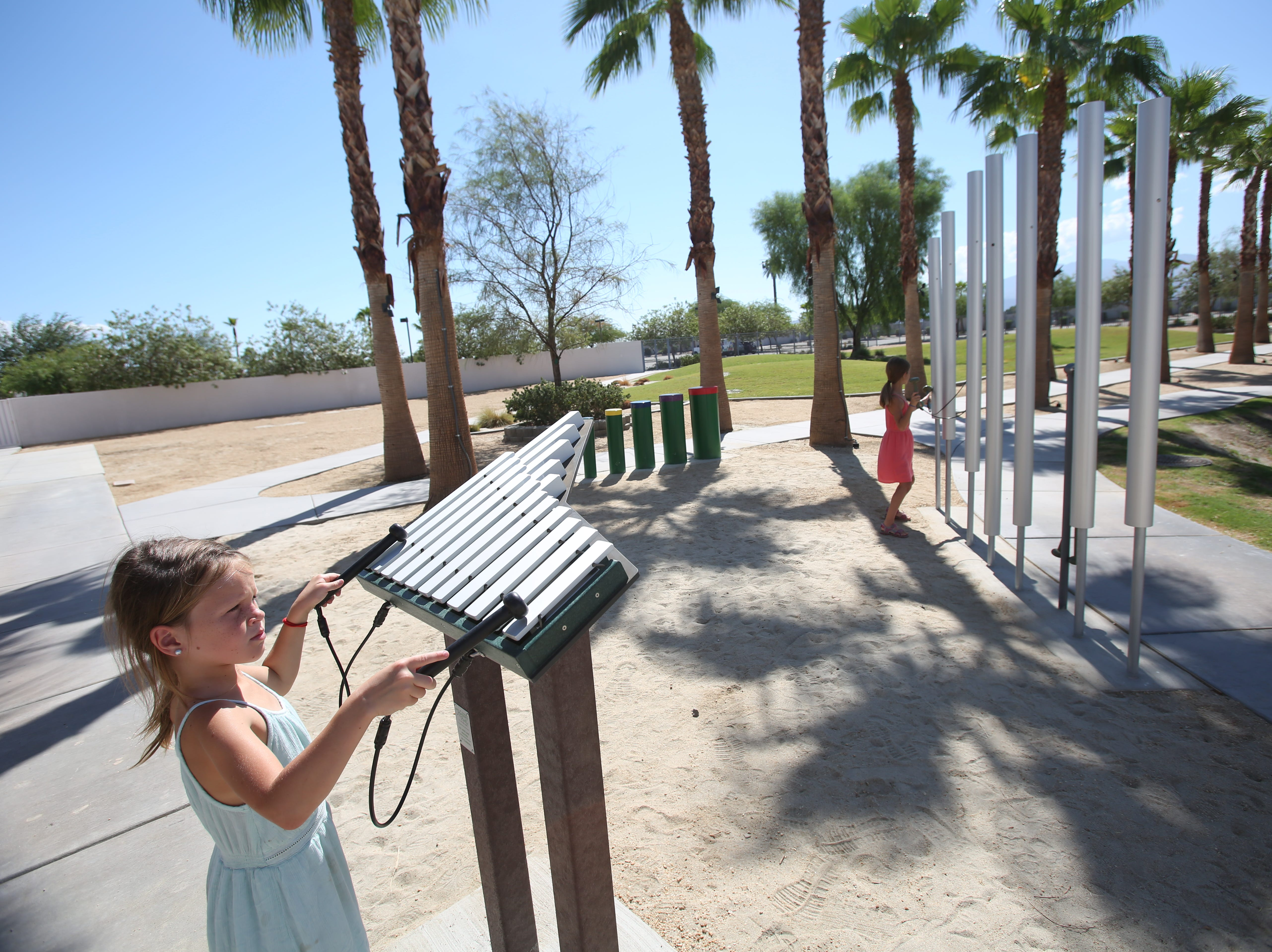 Ashley Demboski, 6 and her sister Allison Demboski, 9 make music at the Children's Discovery Museum in Rancho Mirage on September 22, 2018.