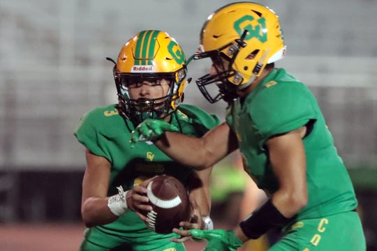 Coachella Valley quarterback Donny Fitzgerald hands off the ball on Friday, September 21, 2018 in Thermal during play with Twentynine Palms.