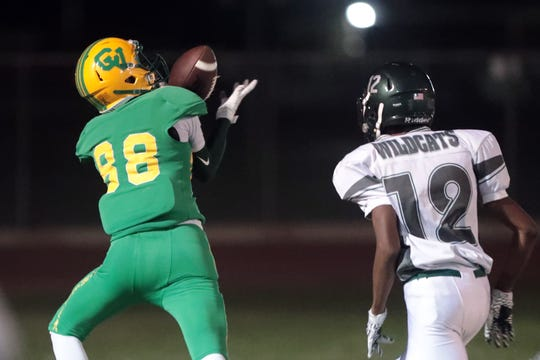 Coachella Valley's Rafael Sanchez catches a pass to start his touchdown run on Friday, September 21, 2018 in Thermal during play with Twentynine Palms.