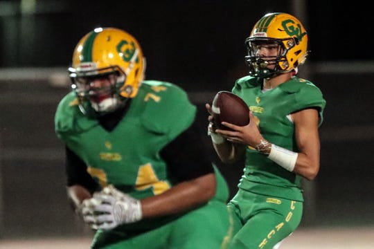 Coachella Valley quarterback Donny Fitzgerald looks for an opening on Friday, September 21, 2018 in Thermal during play with Twentynine Palms.