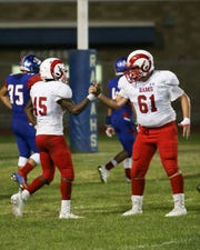Desert Mirage running back Manny Ridge, left, celebrates with lineman Juan Espinoza after scoring a touchdown during the first half Friday, Sept. 21, 2018.