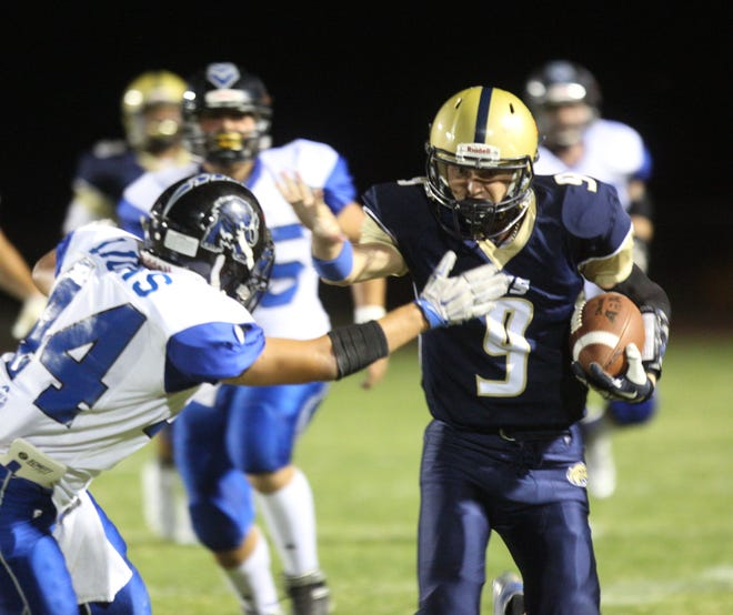``Desert Hot Springs' Nathan Kelly runs for yardage against Cathedral City High School on September 21, 2018 at DHS.