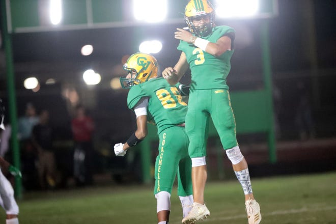 Coachella Valley's Rafael Sanchez, left, celebrate his touchdown with quarterback Donny Fitzgerald who threw him the pass in the first quarter on Friday, September 21, 2018 in Thermal during play with Twentynine Palms.