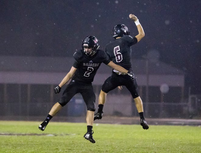 Garon Finley (6) and Tyler England (2) celebrate after catching a pass in the endzone to tie the score at 25-25  during the Pine Forest vs Navarre football game at Navarre High School in Navarre on Friday, September 21, 2018.