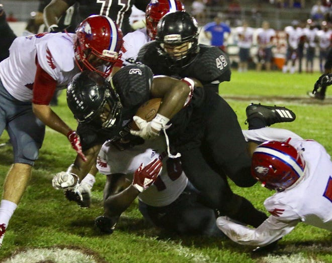 Action from Friday night's game between Navarre High and Pine Forest High in Navarre.