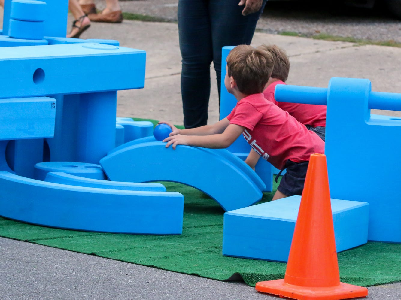 Kids play with large building blocks in one of the PARK(ing) Day spots created during Gallery Night on Friday, Sept. 21, 2018.