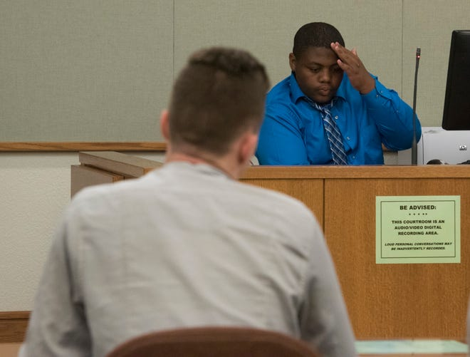Cam'Ron Hill answers questions from Gabriel Lowery, a Teen Court juror, during a peer-to-peer hearing on Tuesday, Sept. 18, 2018.