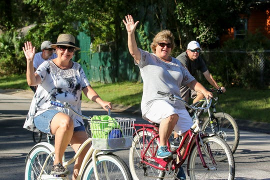 Hundreds of people participate in Bike Pensacola's September Slow Ride through East Hill on Saturday, Sept. 22, 2018. Each month, with a police escort, bicyclists make their way through different neighborhoods, mostly within the city limits, for a relaxing group ride while also bringing awareness to bicycle safety and sharing the road with vehicles. The next Slow Ride is scheduled for October 13 and will start near Episcopal Day School in downtown Pensacola.