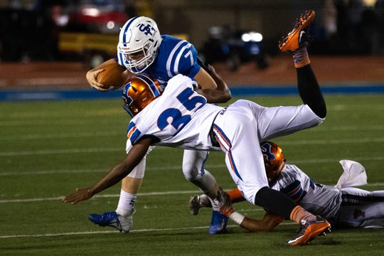 Spring Grove's Matthew Jarvis (7) is brought down by York High's Marcellus John (35) during a football game between York High and Spring Grove, Friday, Sept. 21, 2018, in Spring Grove. The York High Bearcats beat the Spring Grove Rockets 55-14.