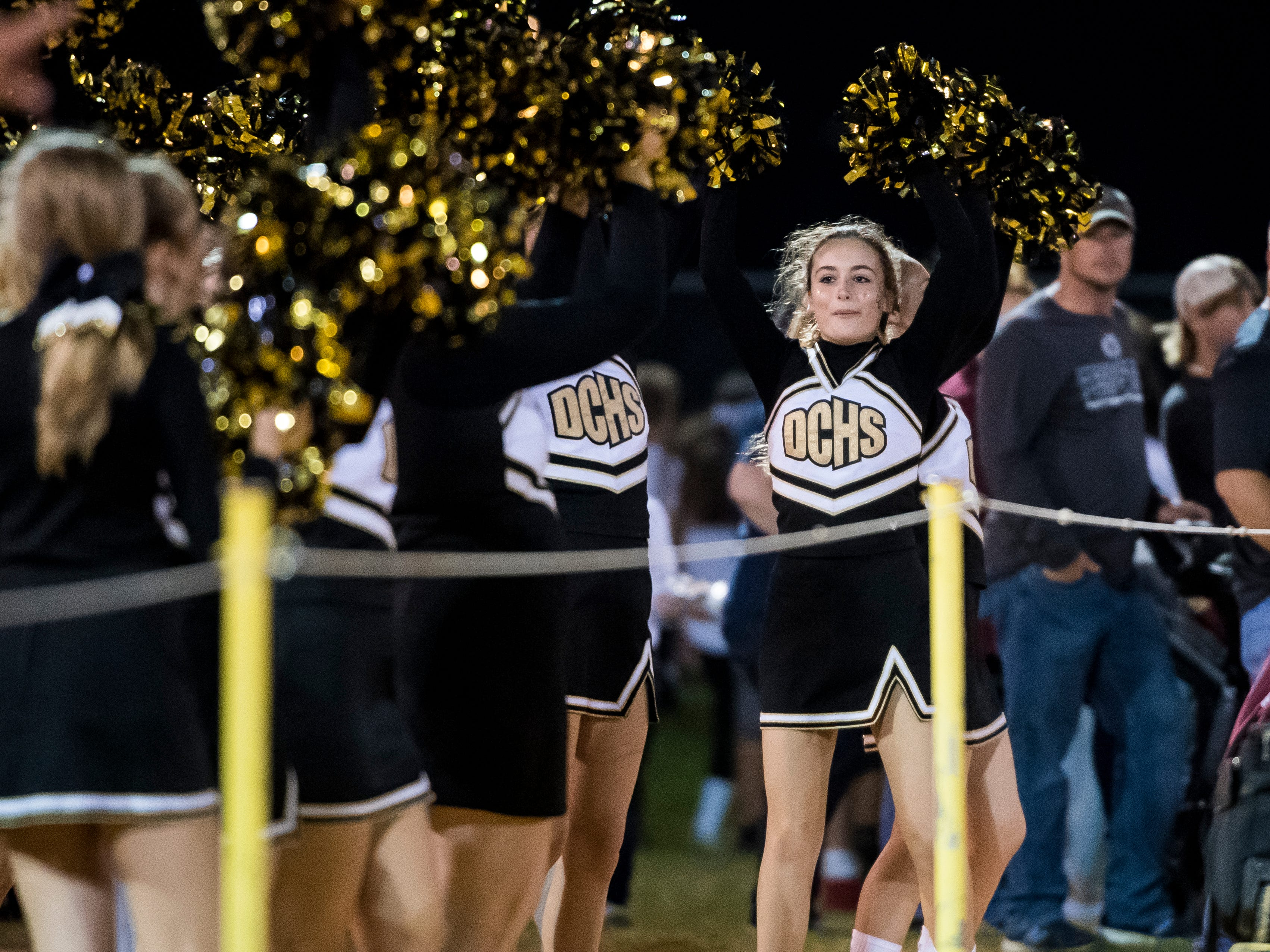 Delone Catholic cheerleaders during Friday's game against Littlestown on Friday, September 21, 2018. The Squires topped the Bolts 27-7.