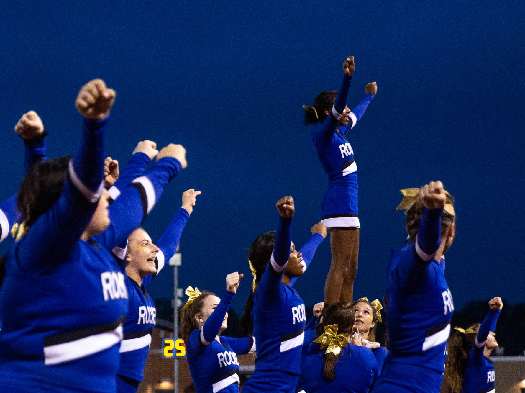 Spring Grove cheerleaders cheer during a football game between York High and Spring Grove, Friday, Sept. 21, 2018, in Spring Grove.