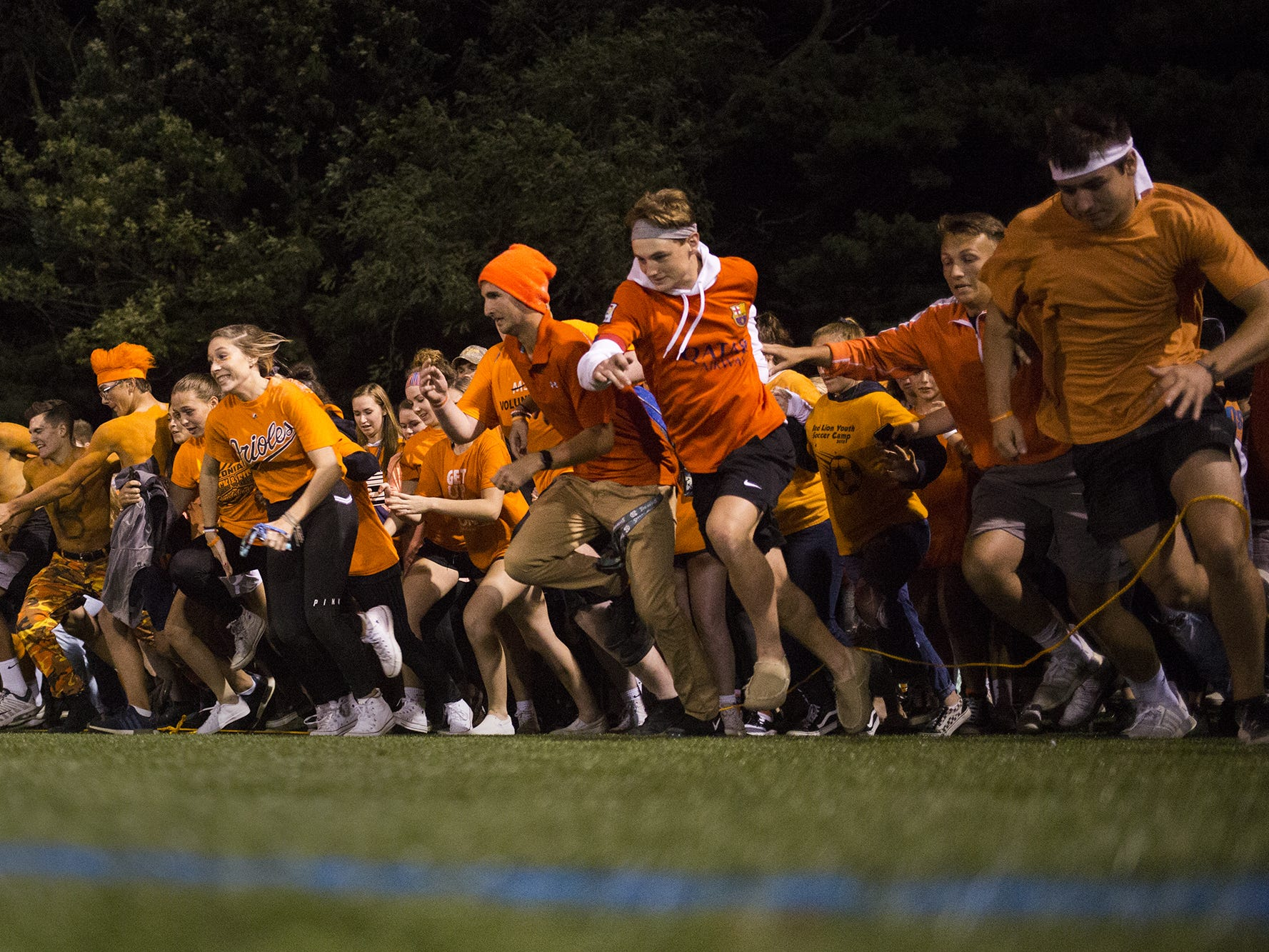 Red Lion students rush onto the field after the game. Red Lion defeats South Western 37-7 in football at Horn Field in Red Lion, Friday, September 21, 2018.