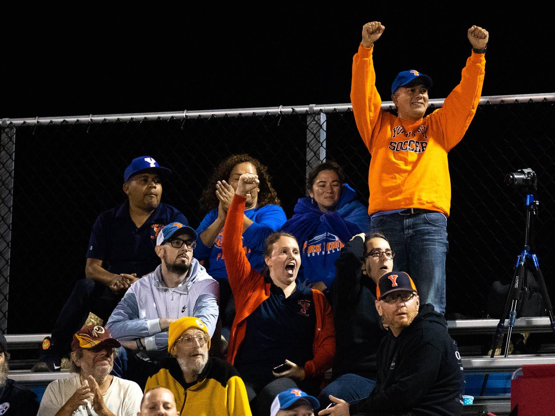 York High fans cheer during a football game between York High and Spring Grove, Friday, Sept. 21, 2018, in Spring Grove. The York High Bearcats beat the Spring Grove Rockets 55-14.