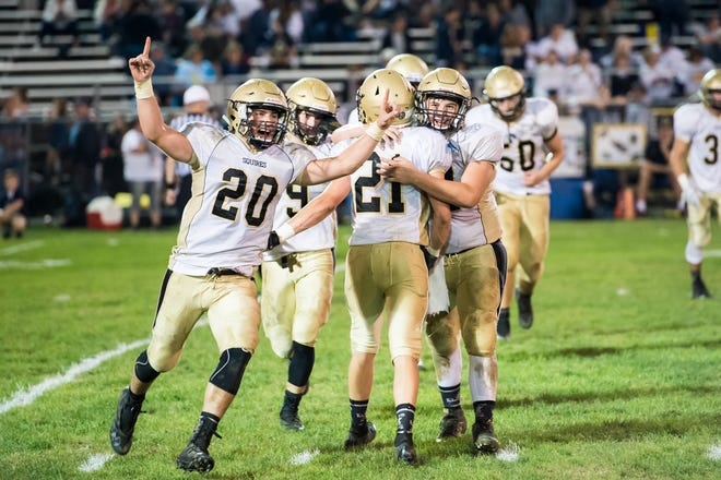 Delone Catholic's Tyler Monto (20) runs off the field in celebration after the Squires beat Littlestown 27-7 and improved to 5-0 on the season Friday, September 21, 2018. Monto finished the game with one receiving touchdown and two interceptions (one returned for a touchdown).