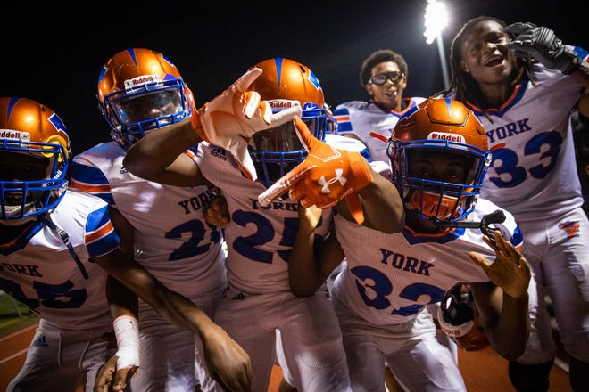 York High players celebrate after their 55-14 victory against Spring Grove on Friday, Sept. 21, 2018.