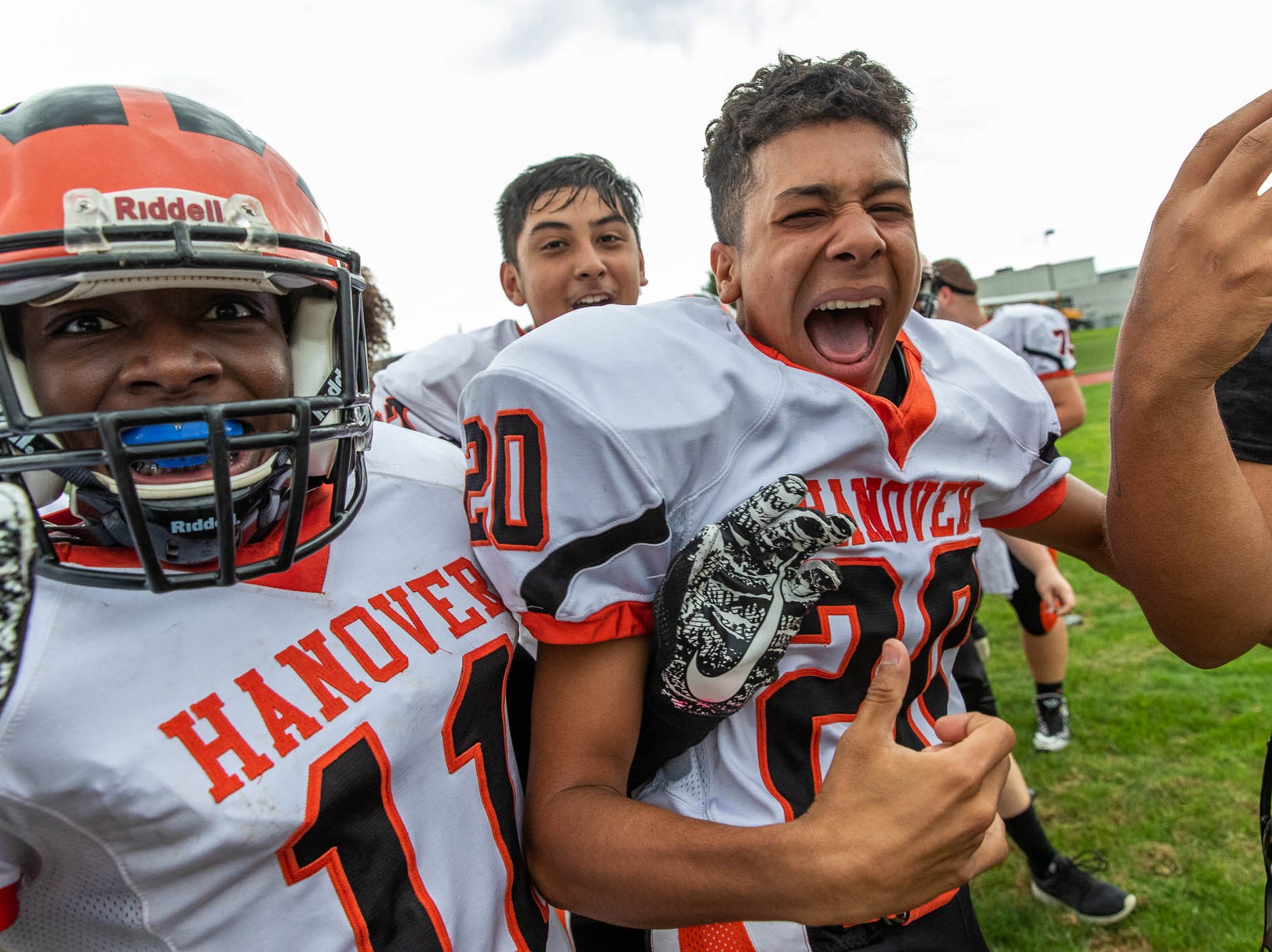 Hanover's Dominic Taylor (20) celebrates his team's win against York Tech, Saturday, Sept. 22, 2018, at the York County School of Technology in York Township. The Nighthawks defeated the York Tech Spartans 44-12, giving Hanover their first win of the season.