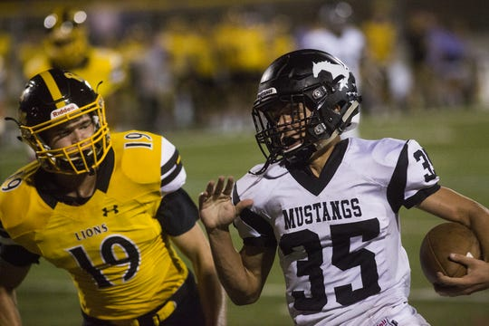 Red Lion's Taylor Seifert, left, chases South Western's Tyler Higdon. Red Lion defeats South Western 37-7 in football at Horn Field in Red Lion, Friday, September 21, 2018.