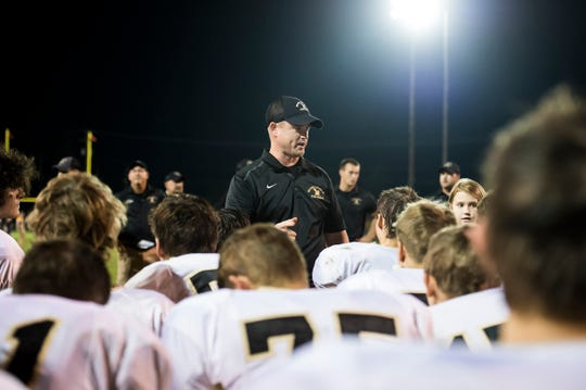 Delone Catholic head coach Corey Zortman speaks with his team after Friday's win against Littlestown September 21, 2018.