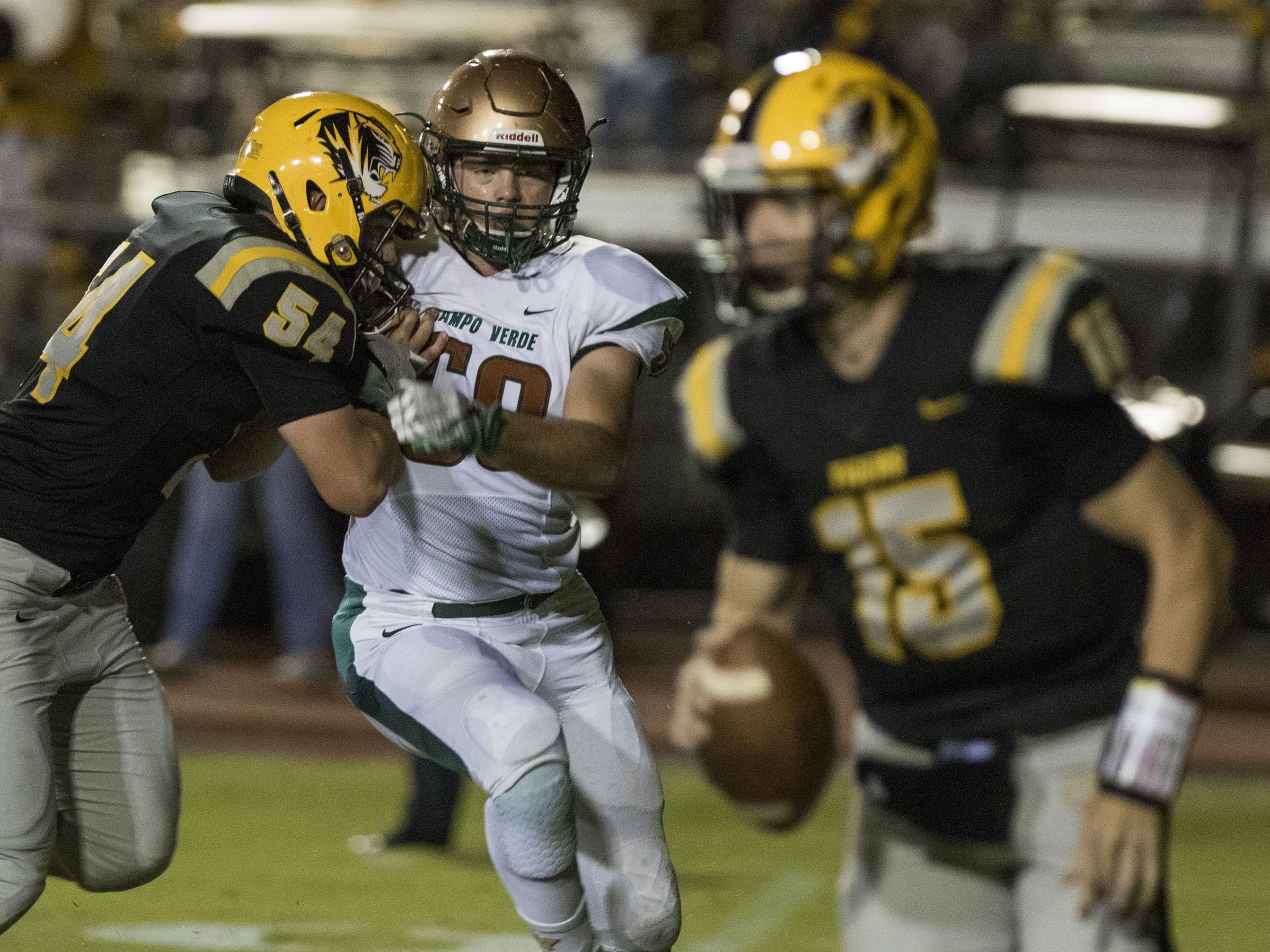 Campo Verde's Trevor Kauer eyes Gilbert quarterback Will Plummer during their game in Gilbert Friday, Sept. 21, 2018. #azhsfb