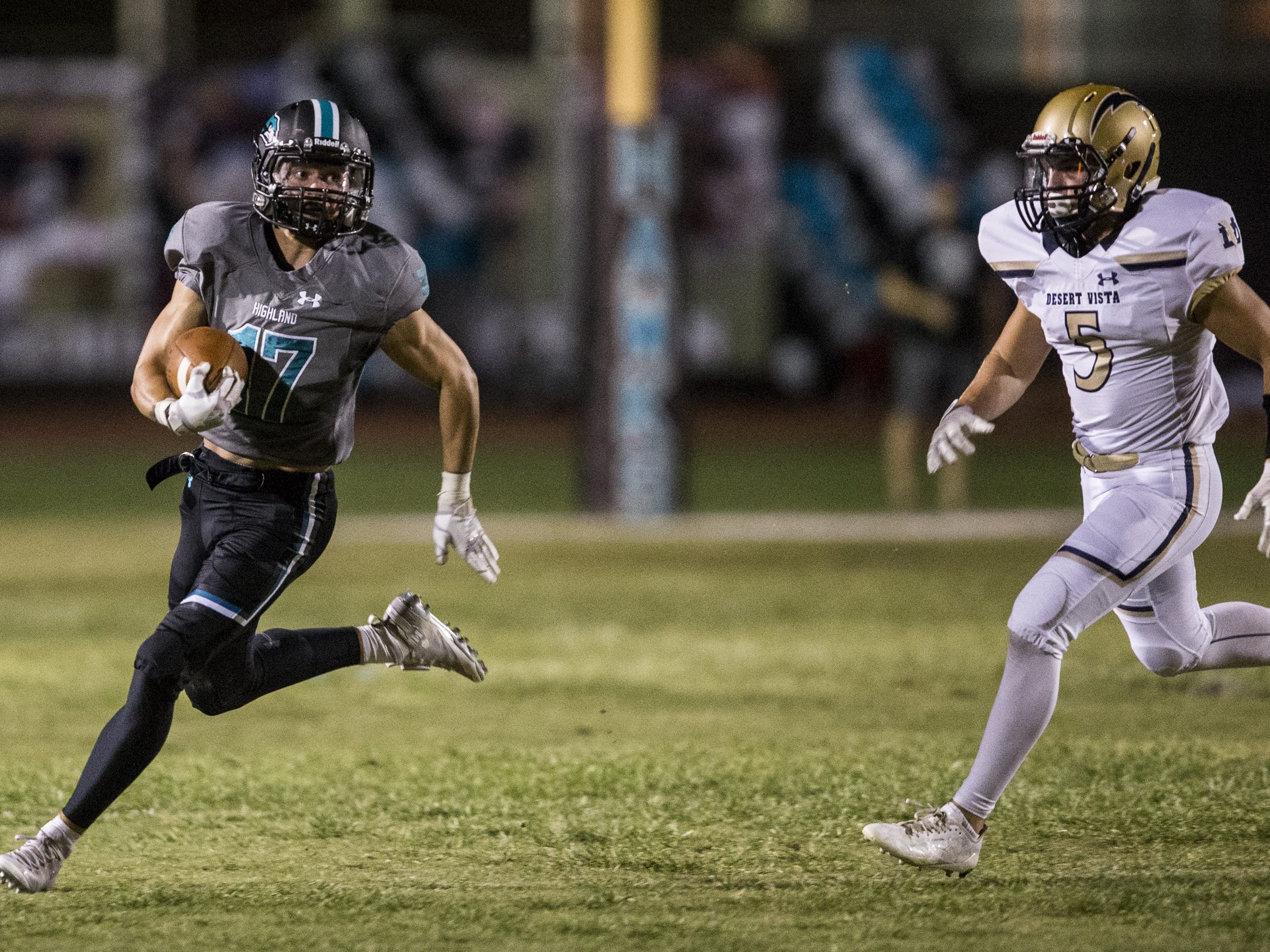 Highland's Tanner Crandall returns a punt against Desert Vista in the 2nd quarter on Friday, Sept. 21, 2018, at Highland High School in Gilbert, Ariz.   #azhsfb
