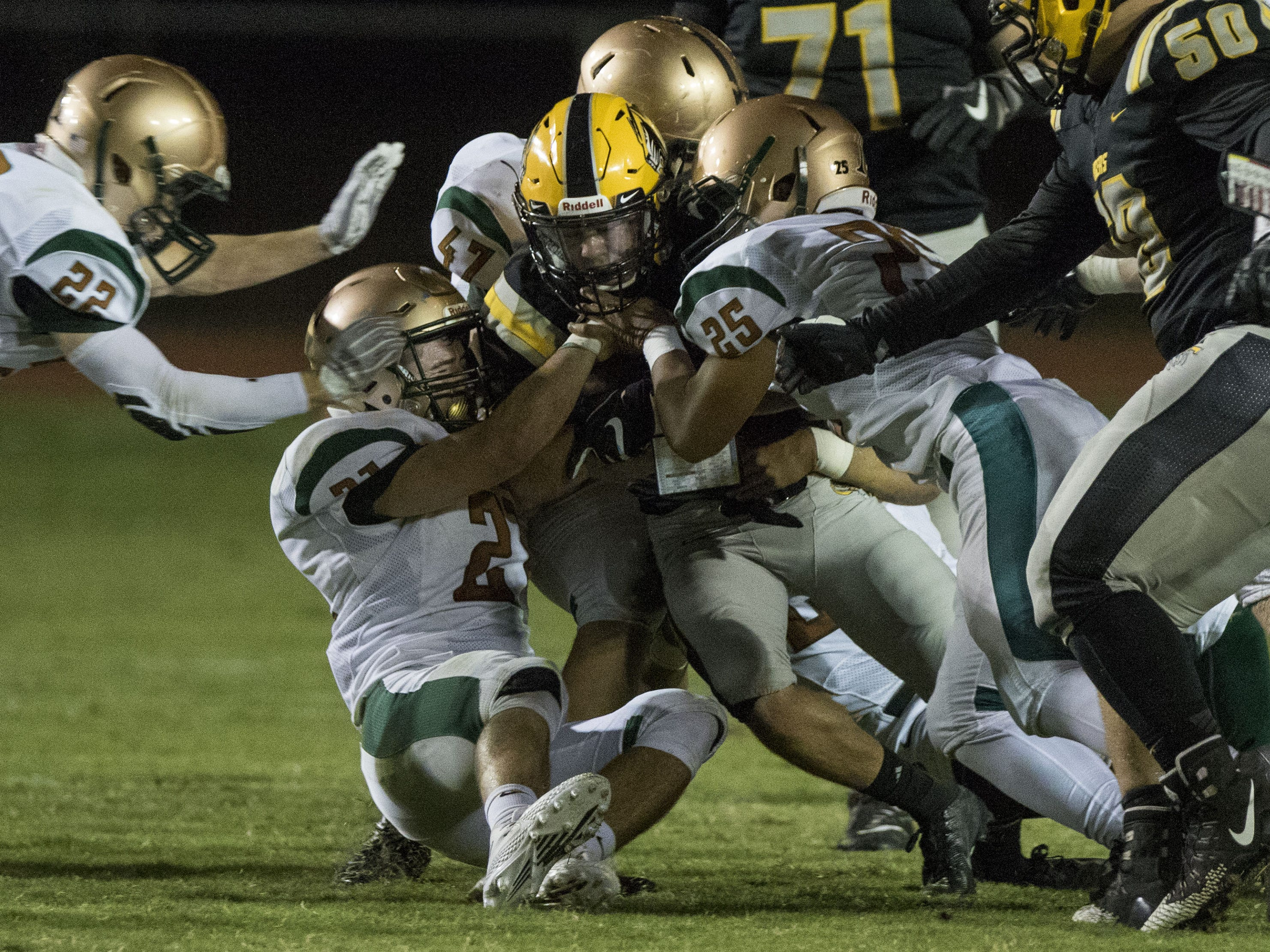 Campo Verde's defense smothers Gilbert's Anthony Elzy during their game in Gilbert Friday, Sept. 21, 2018. #azhsfb