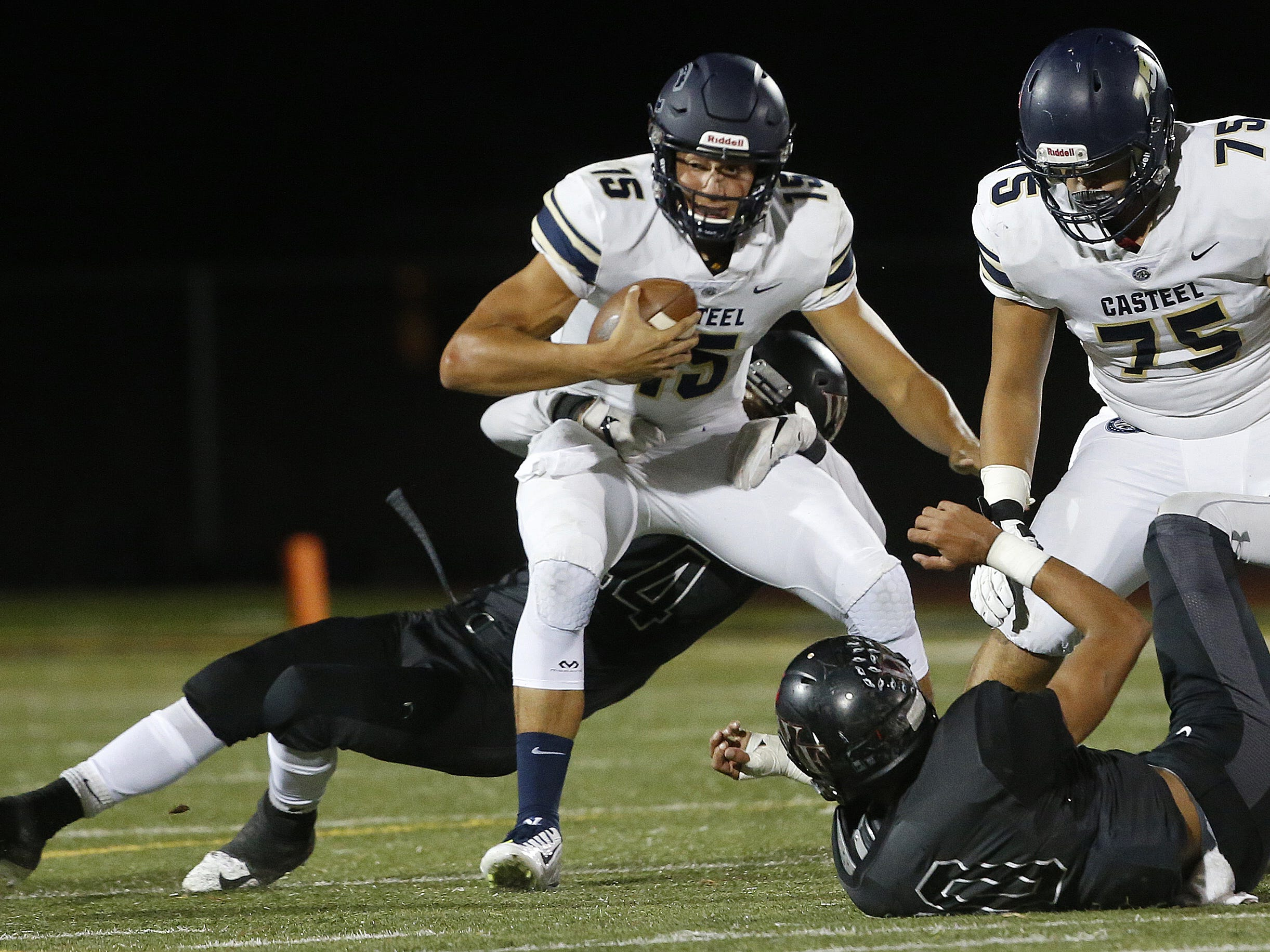 Williams Field's Collin Knight (54) sacks Casteel's Gunner Cruz (15) at Williams Field High School in Gilbert, Ariz. on Sept. 21, 2018.  #azhsfb