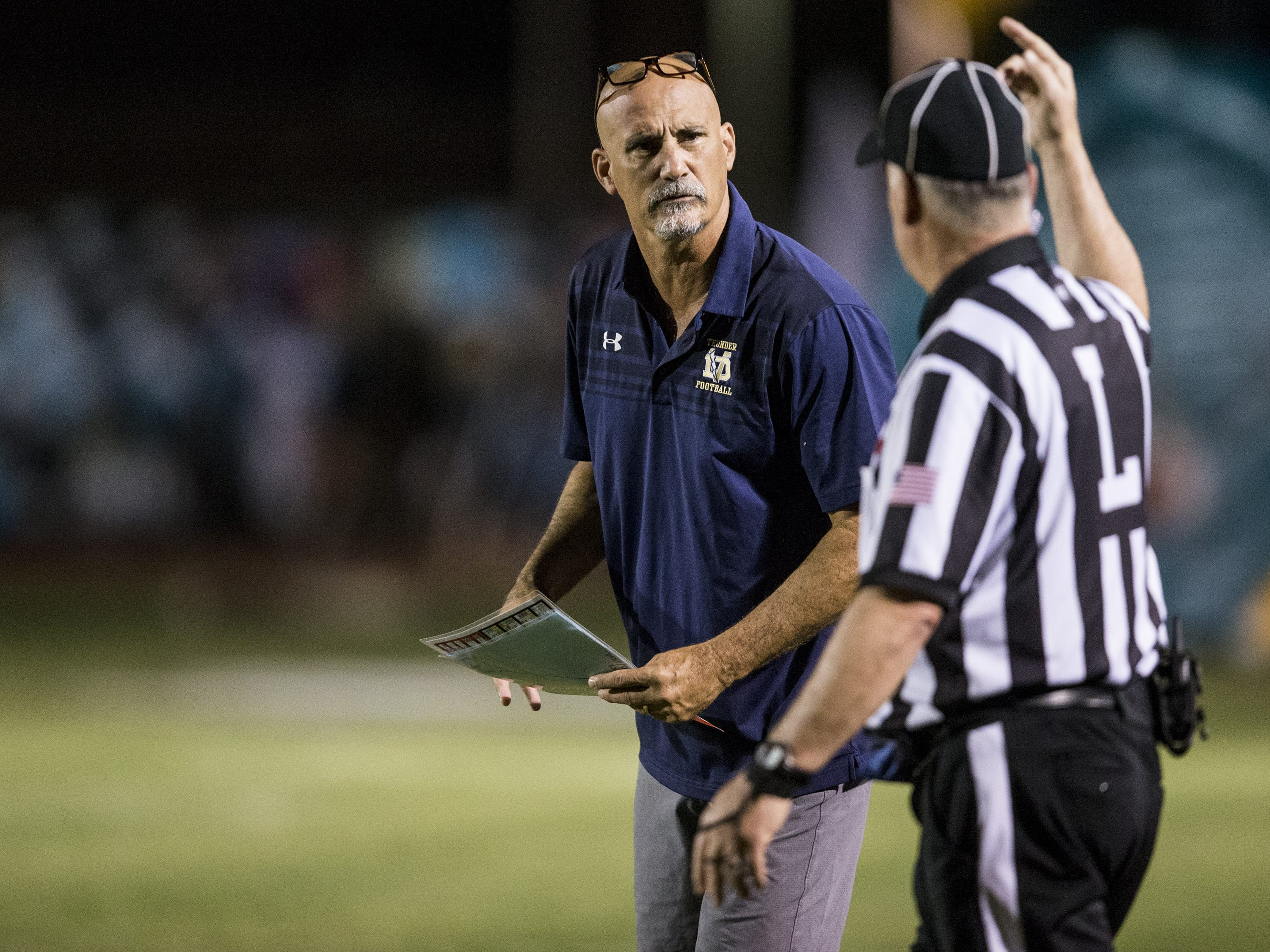 Desert Vista head coach Dan Hinds listens to a referee during the game against Highland on Friday, Sept. 21, 2018, at Highland High School in Gilbert, Ariz.   #azhsfb