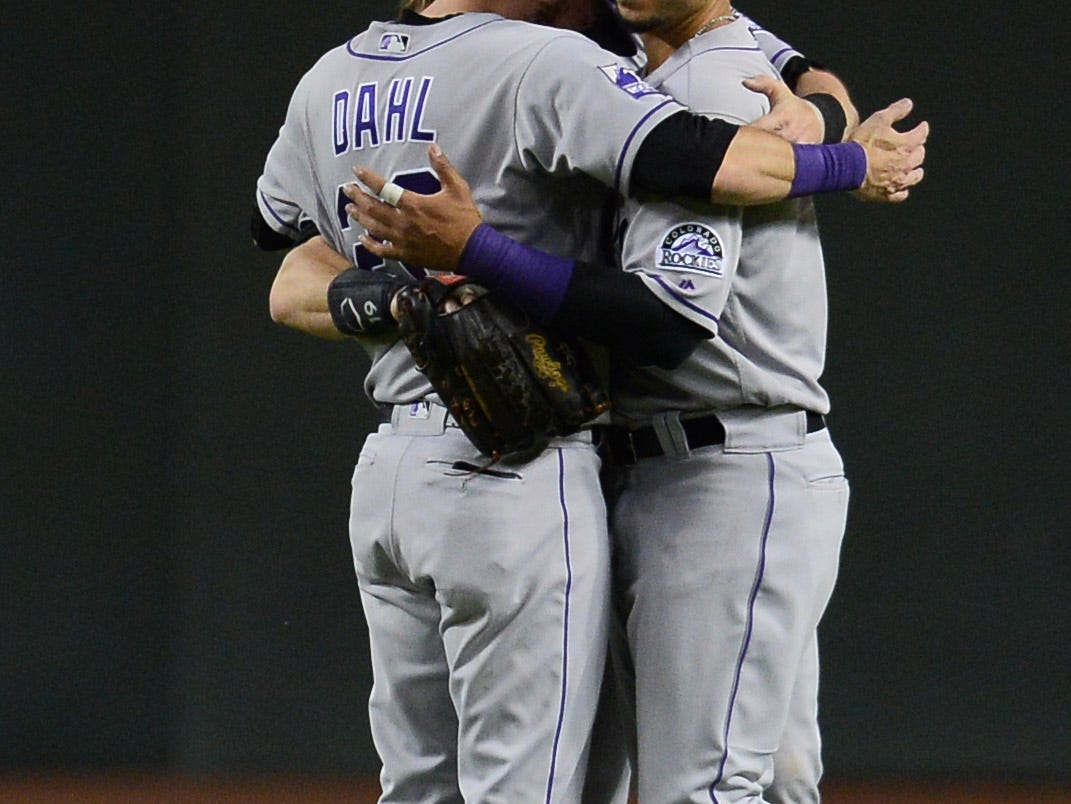 Sep 21, 2018; Phoenix, AZ, USA; Colorado Rockies center fielder Charlie Blackmon (19) left fielder David Dahl (26) and right fielder Carlos Gonzalez (5) hug after defeating the Arizona Diamondbacks at Chase Field.