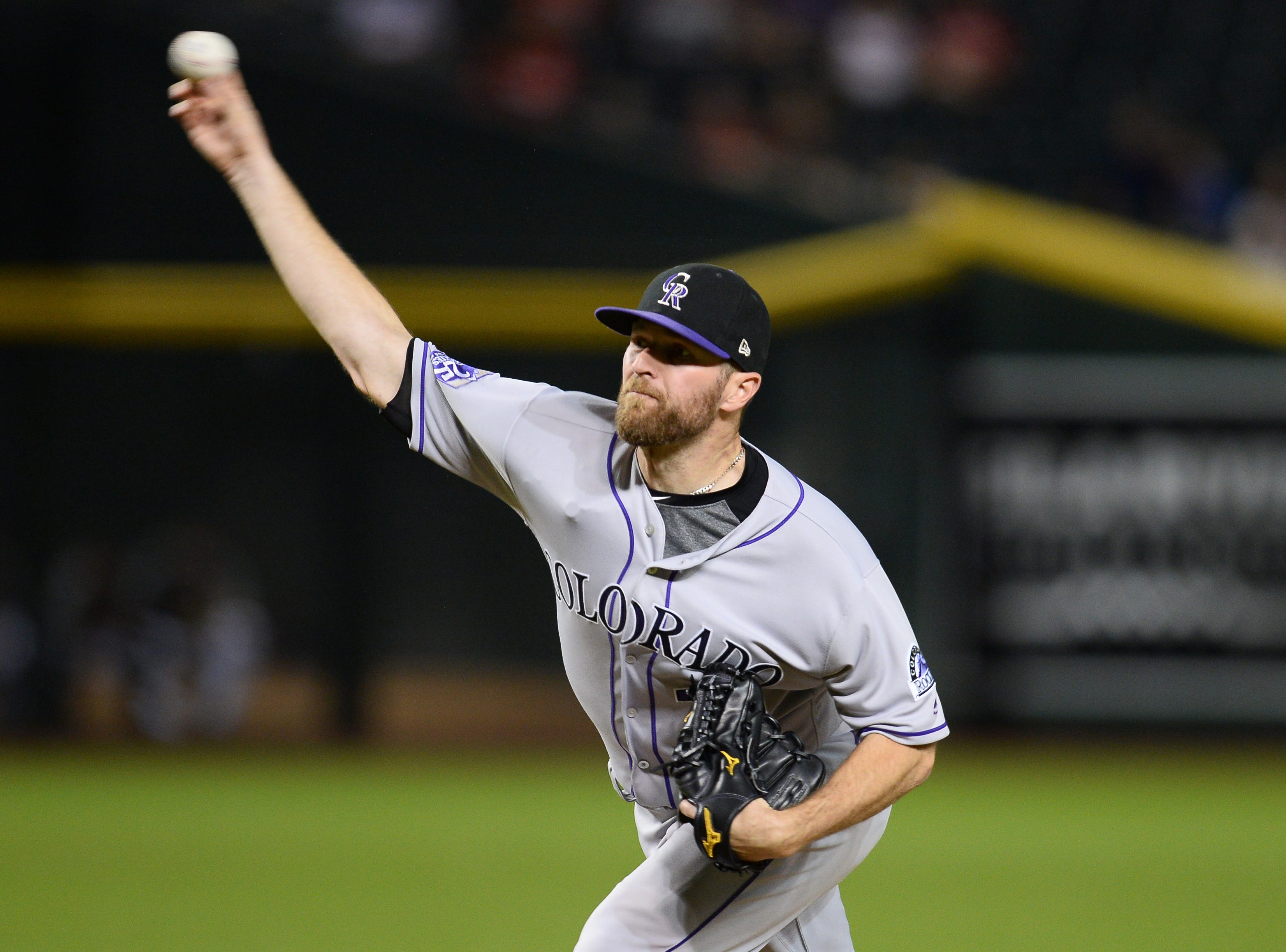Sep 21, 2018; Phoenix, AZ, USA; Colorado Rockies relief pitcher Wade Davis (71) pitches against the Arizona Diamondbacks during the ninth inning at Chase Field.
