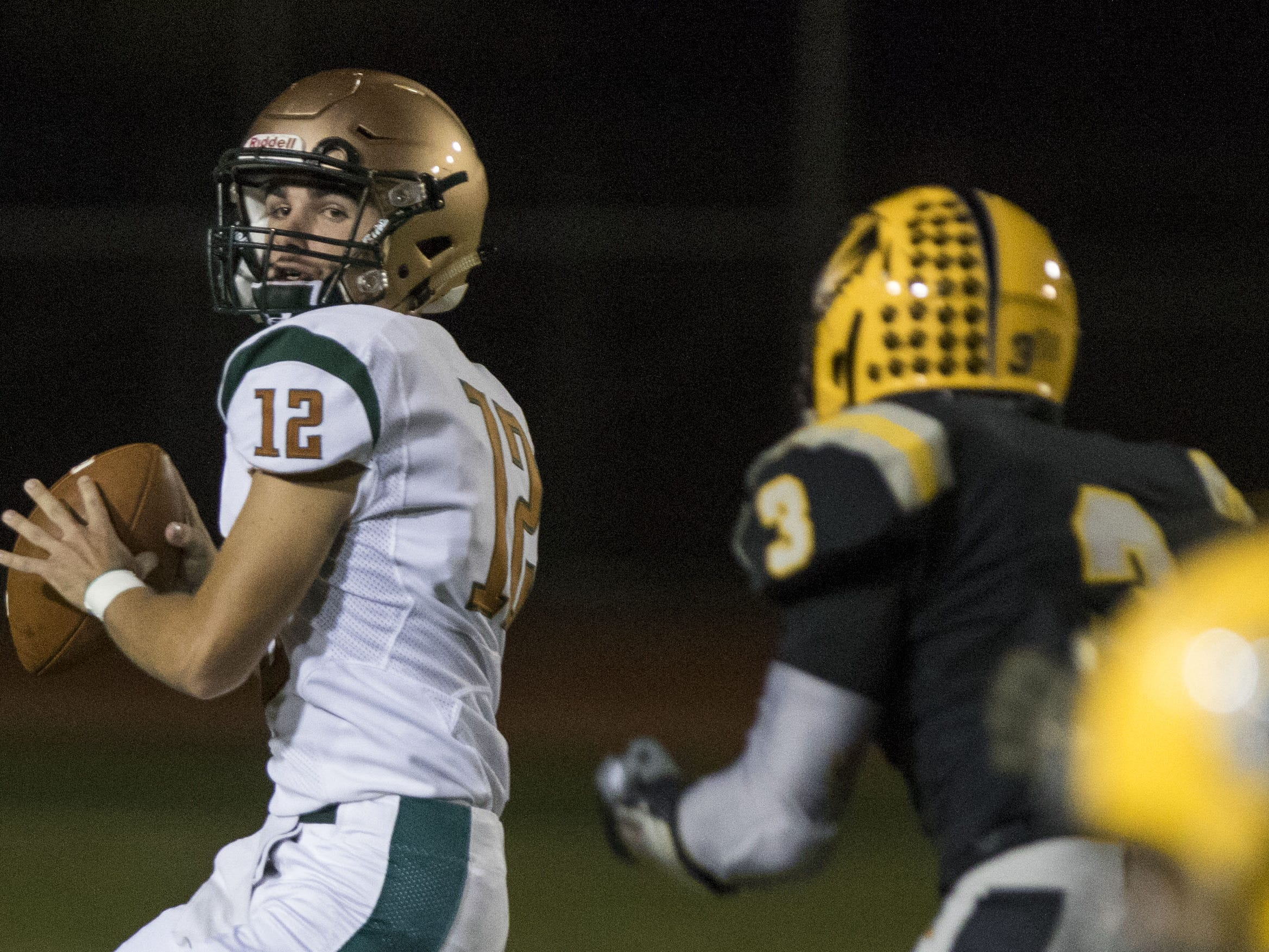Campo Verde quarterback Parker Nuzman looks downfield for a receiver during their game with Gilbert Friday, Sept. 21, 2018. #azhsfb