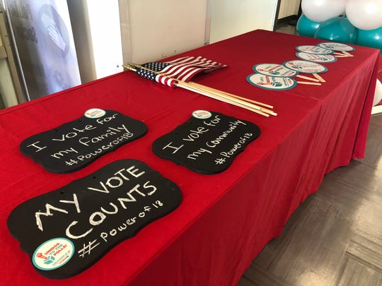 The Power of 18 event social media table, where attendees could take photos with the props to raise voter registration awareness at South Mountain High School on Sept. 22, 2018.