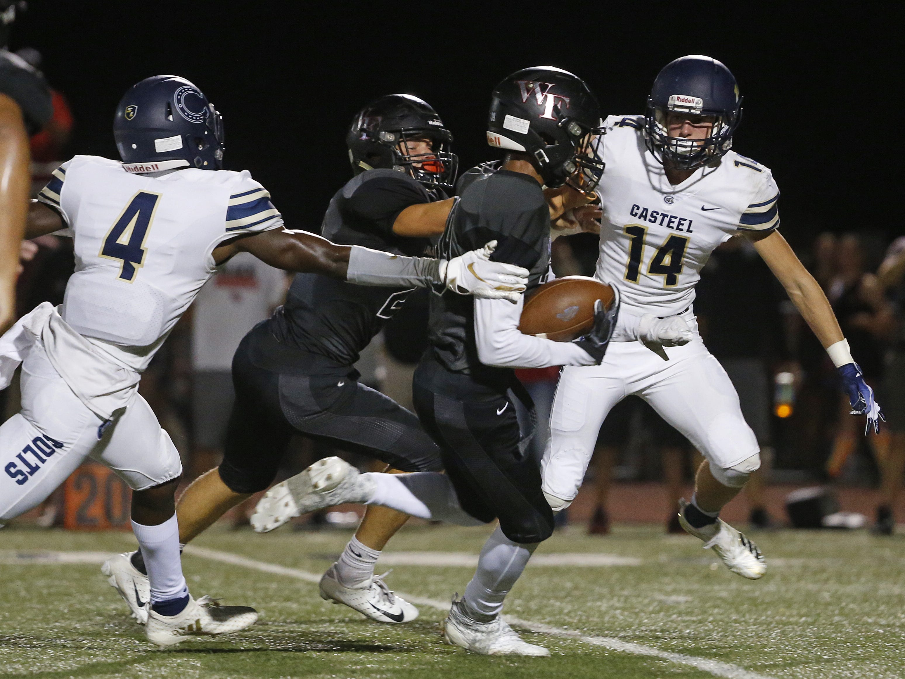 Williams Field's Jadon Pearson (39) returns an interception against Casteel's Gunner Cruz at Williams Field High School in Gilbert, Ariz. on Sept. 21, 2018.  #azhsfb