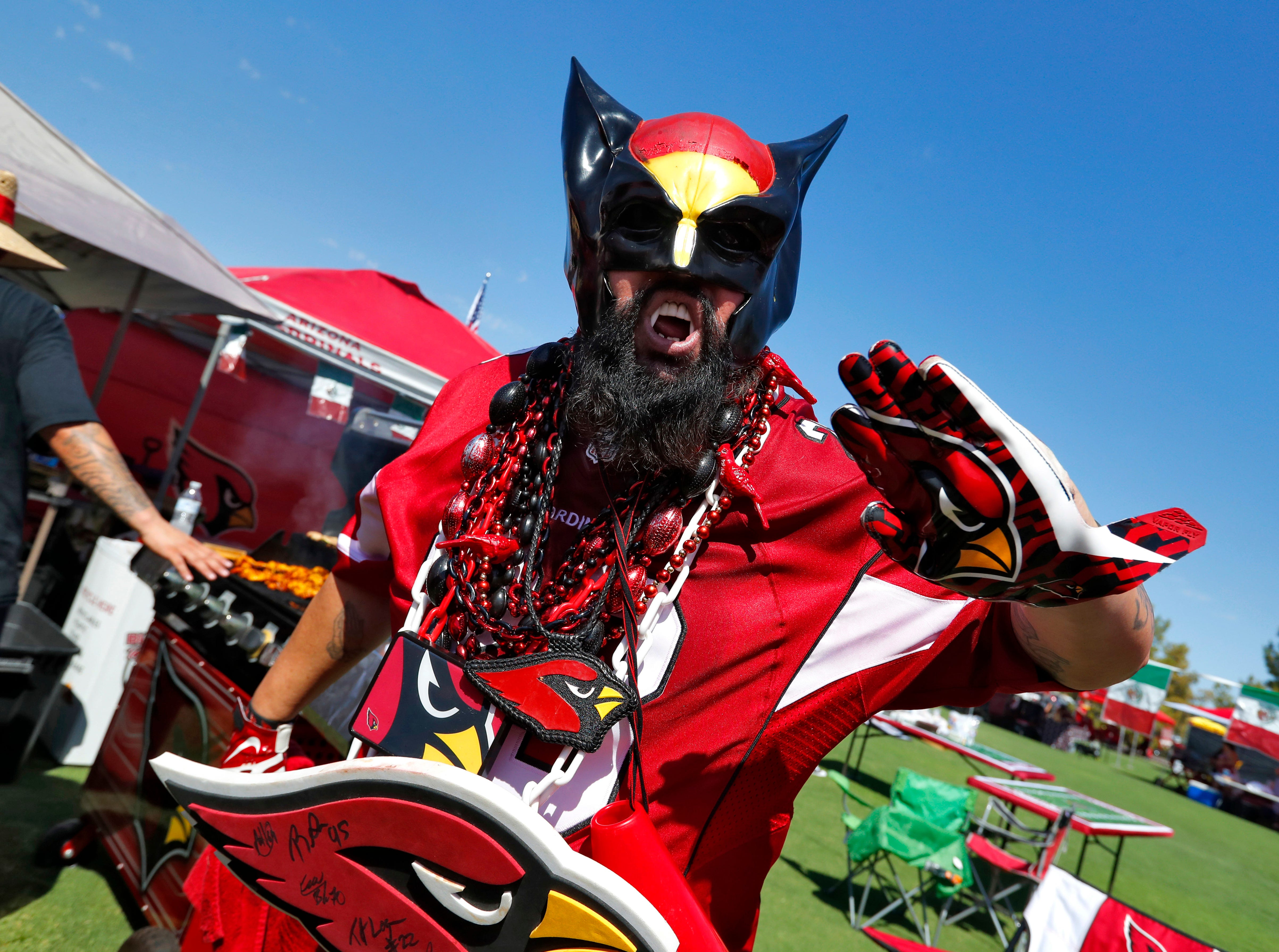 Arizona Cardinals Chris Chavez tailgates prior to an NFL football game against the Washington Redskins, Sunday, Sept. 9, 2018, in Glendale, Ariz.