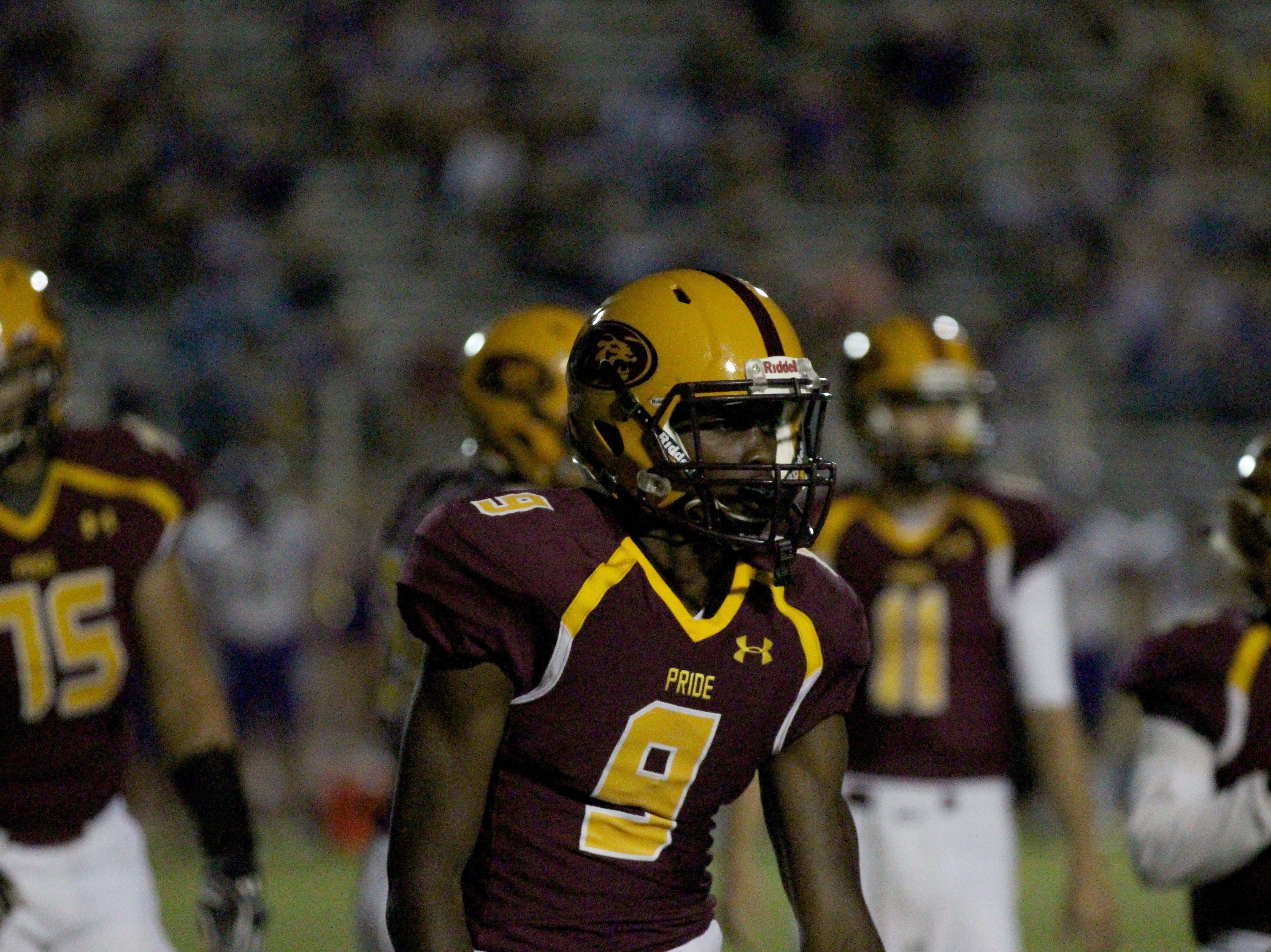 Mountain Pointe's Dominique Davis looks to the sideline in game against Queen Creek on Friday night at Mountain Pointe High School on Sept. 21, 2018.