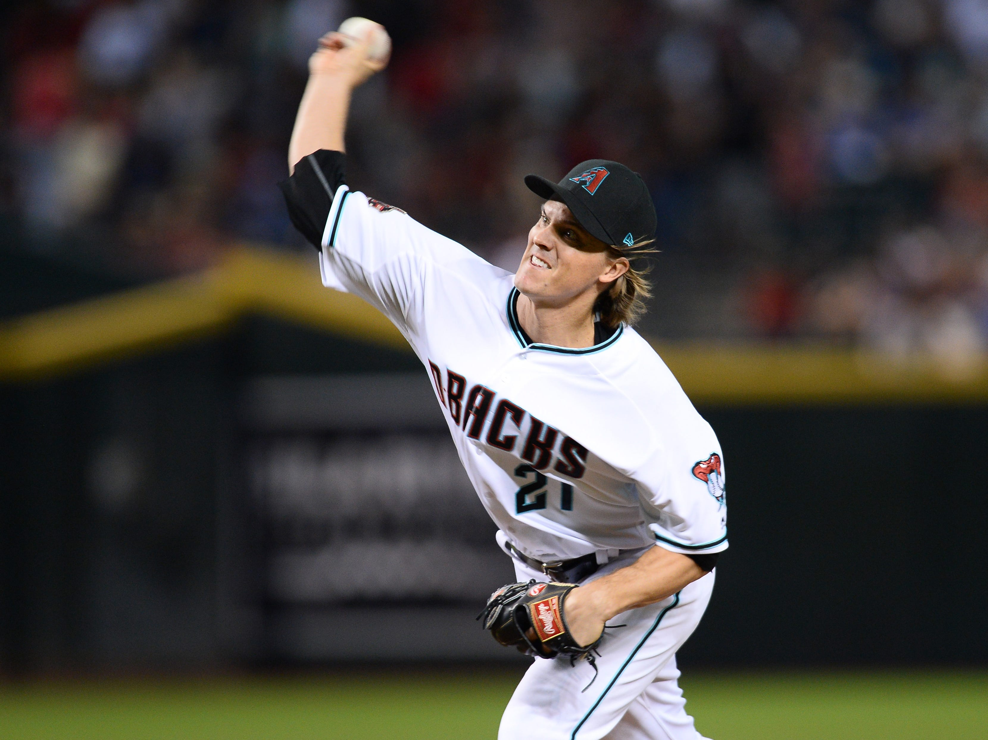 Sep 21, 2018; Phoenix, AZ, USA; Arizona Diamondbacks starting pitcher Zack Greinke (21) pitches against the Colorado Rockies during the first inning at Chase Field.