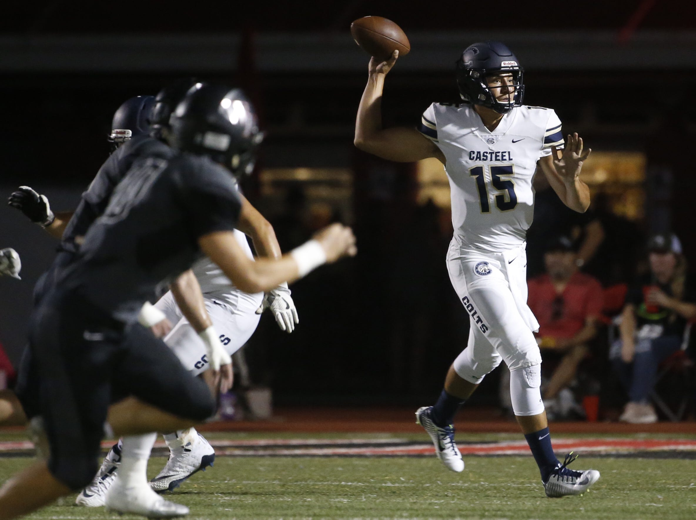 Casteel's Gunner Cruz (15) throws a pass under pressure from Williams Field's Nick Hernandez (80) at Williams Field High School in Gilbert, Ariz. on Sept. 21, 2018.  #azhsfb