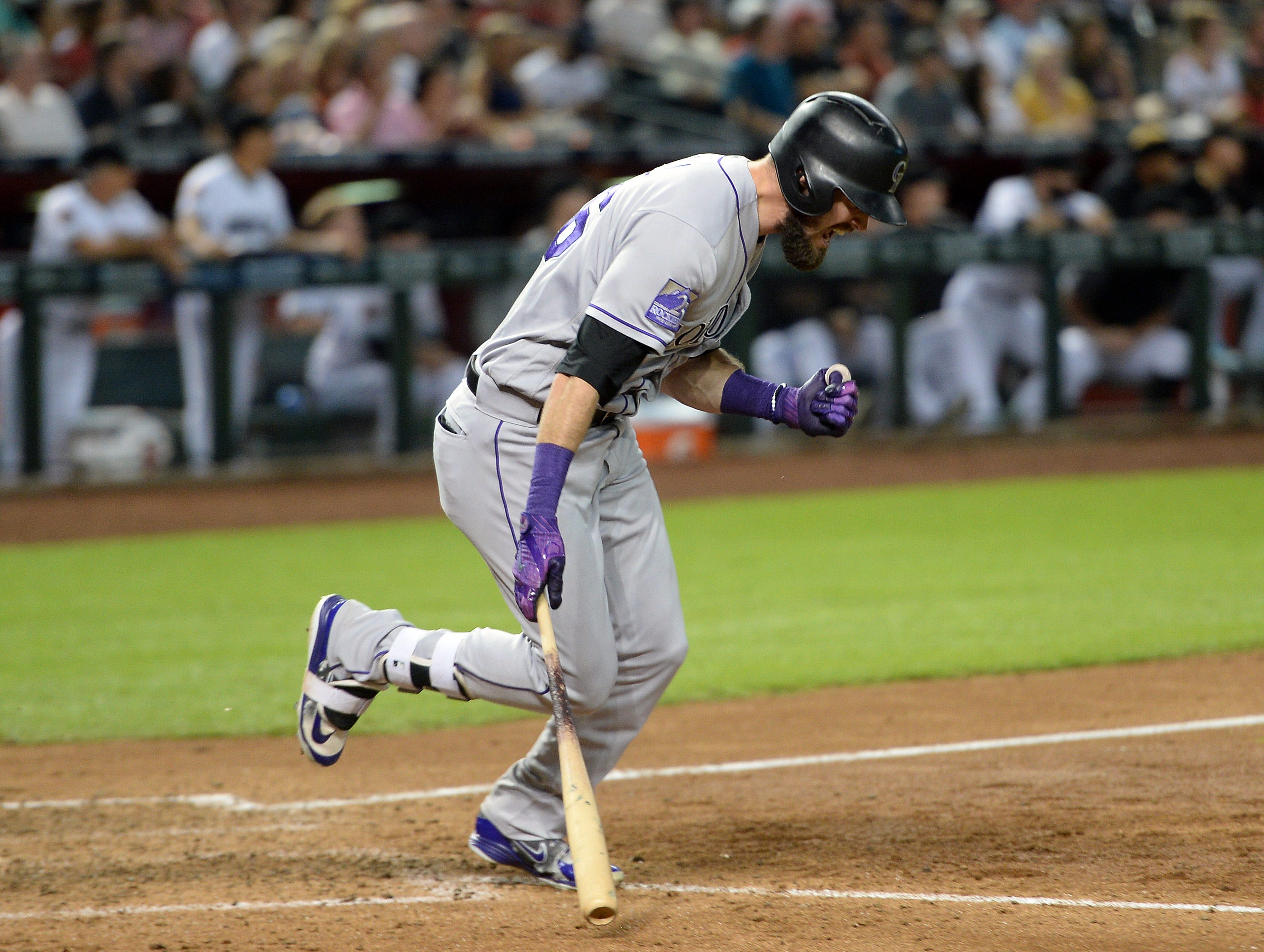 Sep 21, 2018; Phoenix, AZ, USA; Colorado Rockies left fielder David Dahl (26) pumps his fist after hitting an RBI single against the Arizona Diamondbacks during the eighth inning at Chase Field.