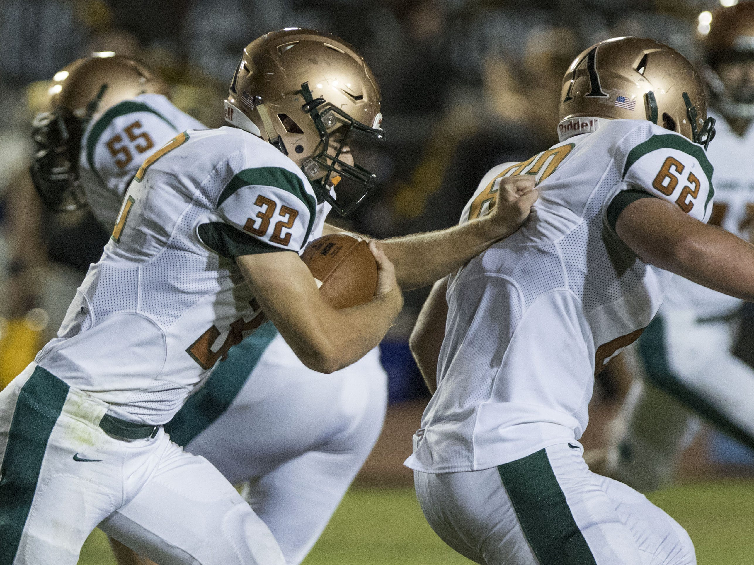 Campo Verde's Matt Leazier follows his blocker Jake Leighty during their game with Gilbert Friday, Sept. 21, 2018. #azhsfb