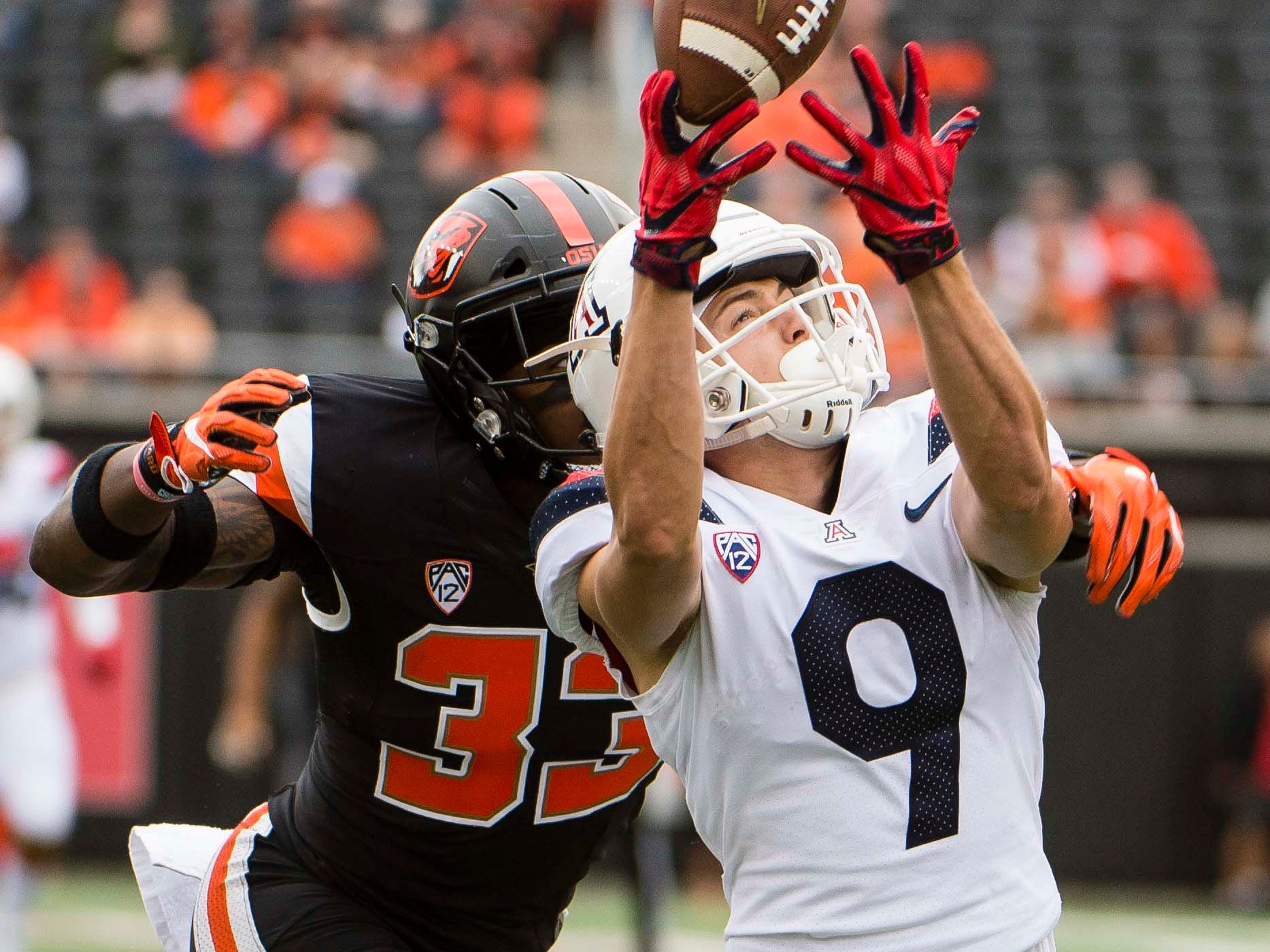 Sep 22, 2018; Corvallis, OR, USA; Oregon State Beavers safety Jalen Moore (33) break up a pass during the first half intended for Arizona Wildcats wide receiver Tony Ellison (9) at Reser Stadium. Mandatory Credit: Troy Wayrynen-USA TODAY Sports