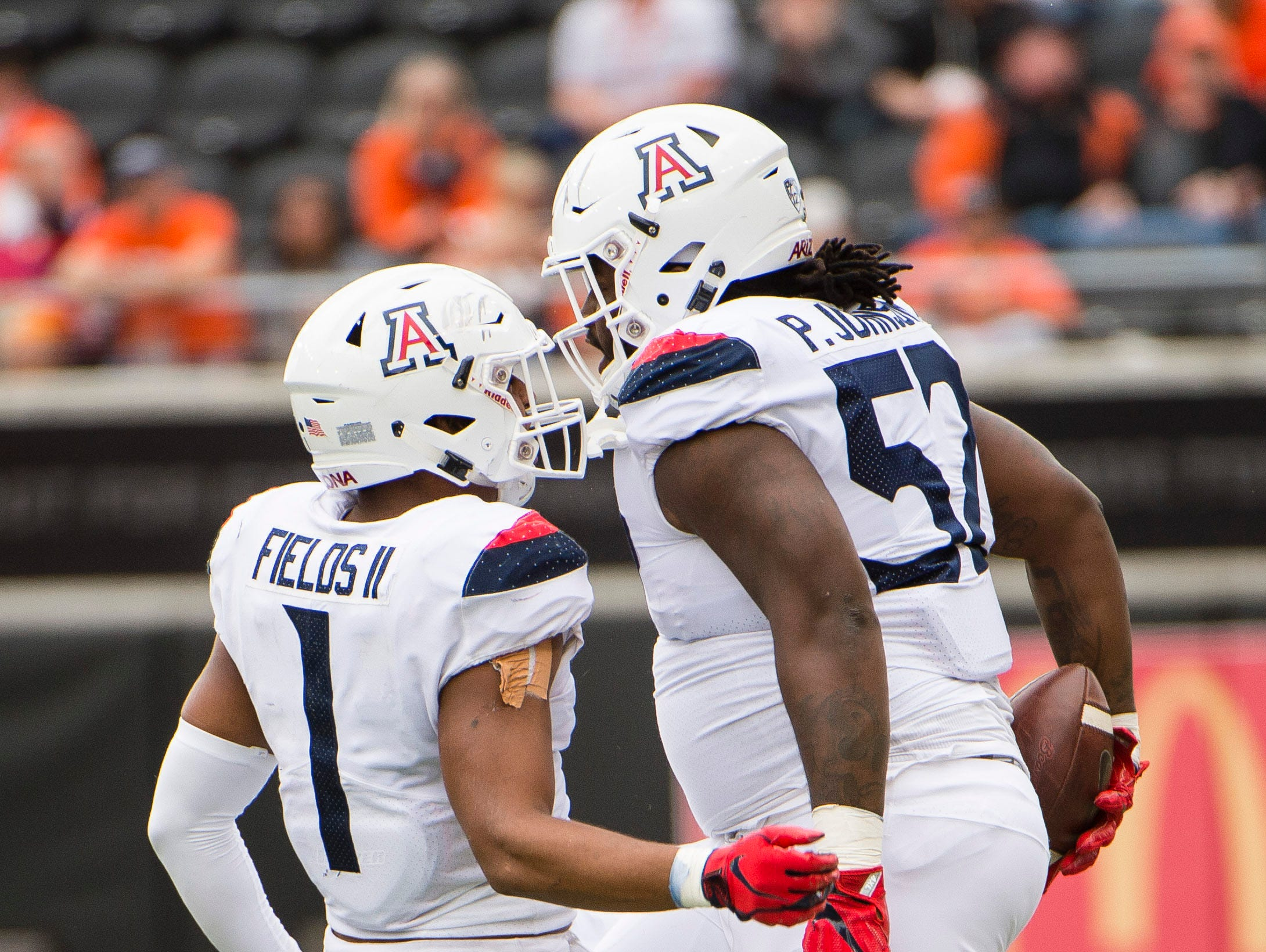 Sep 22, 2018; Corvallis, OR, USA; Arizona Wildcats linebacker Tony Fields II (1) and Arizona Wildcats cornerback Lorenzo Burns (2) celebrate after sacking Oregon State Beavers quarterback Conor Blount (2) during the first half at Reser Stadium.