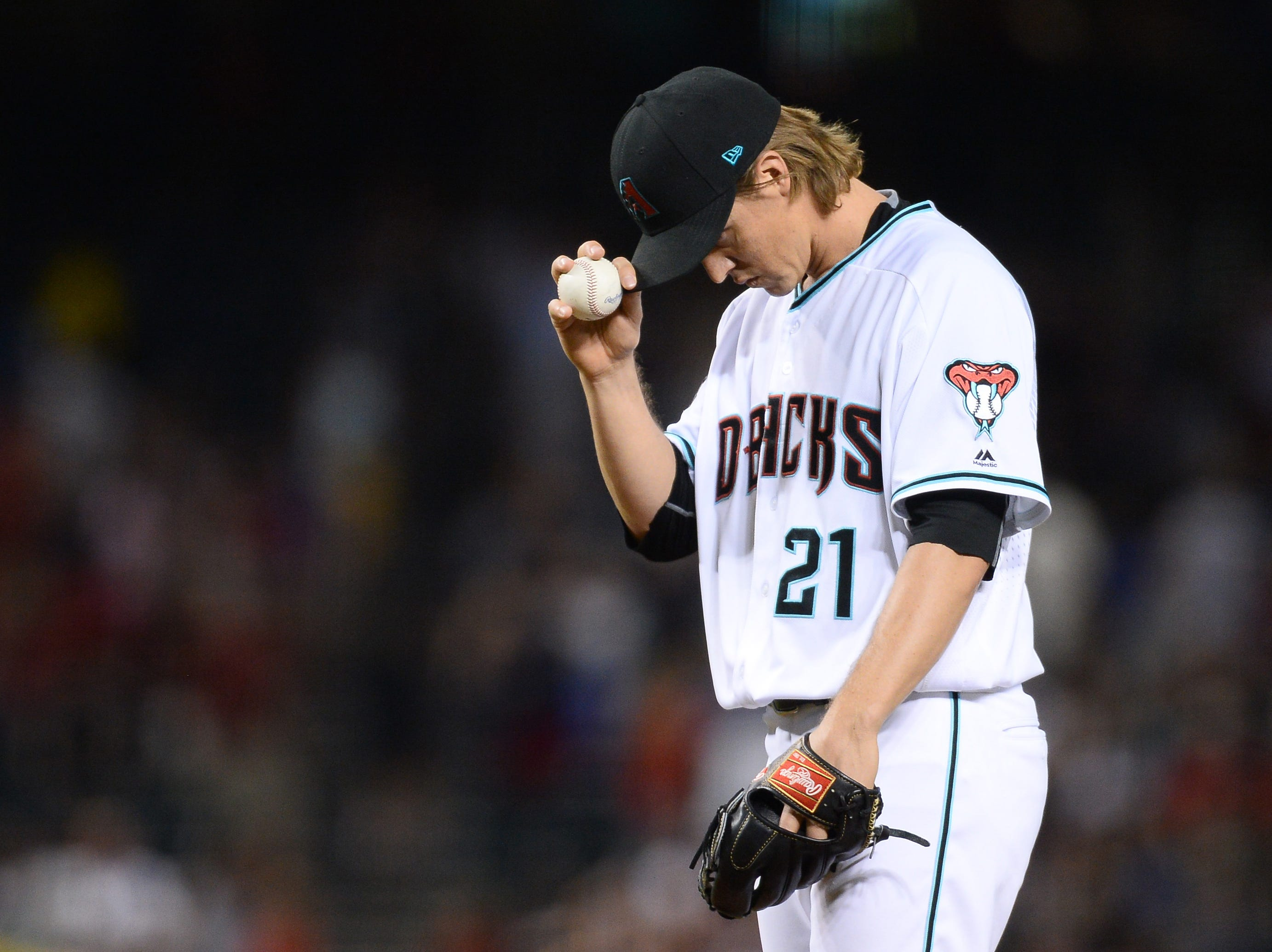 Sep 21, 2018; Phoenix, AZ, USA; Arizona Diamondbacks starting pitcher Zack Greinke (21) looks on against the Colorado Rockies during the first inning at Chase Field.