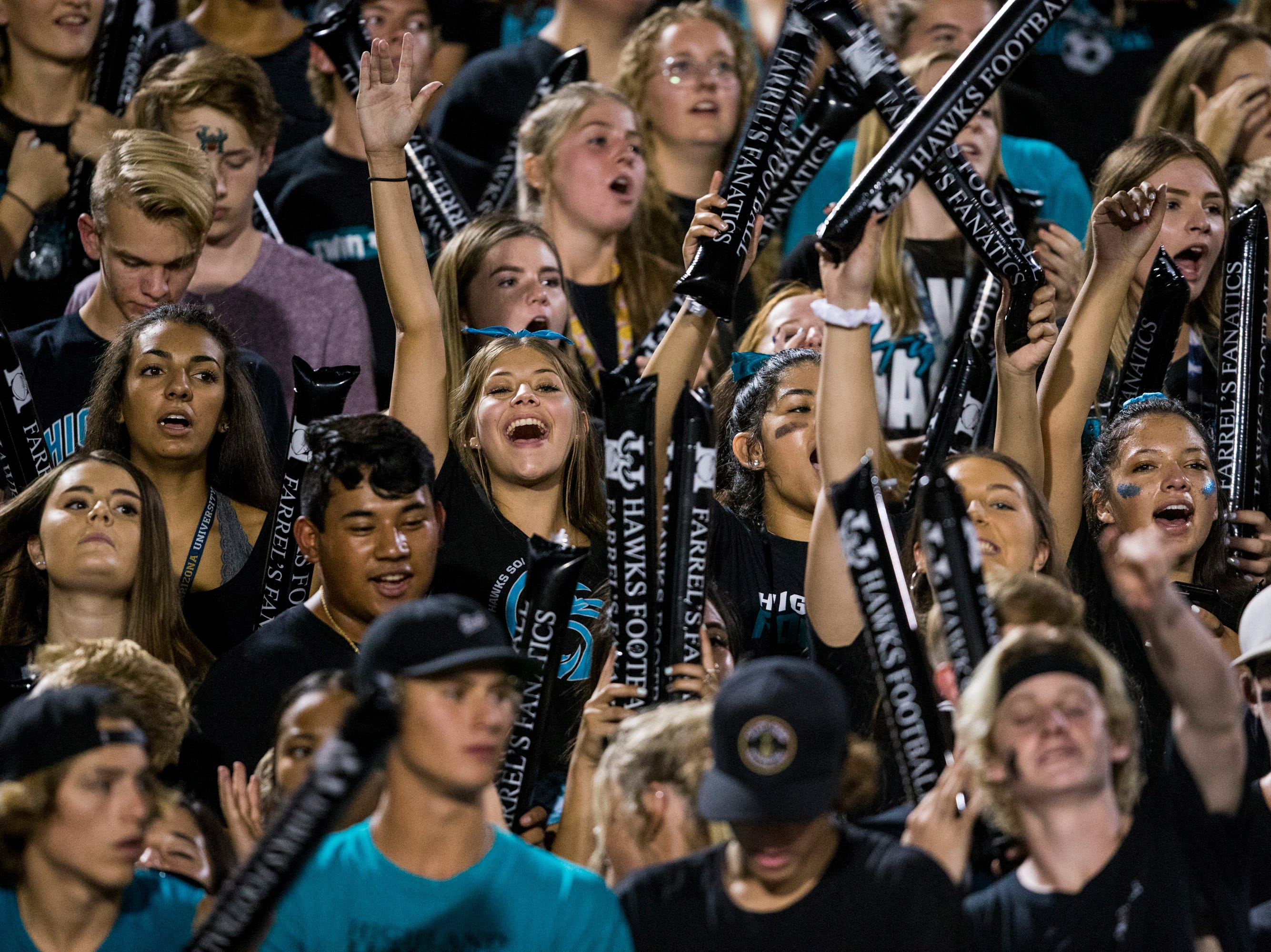 Highland High School football fans cheer during the game against Desert Vista on Friday, Sept. 21, 2018, at Highland High School in Gilbert, Ariz.   #azhsfb