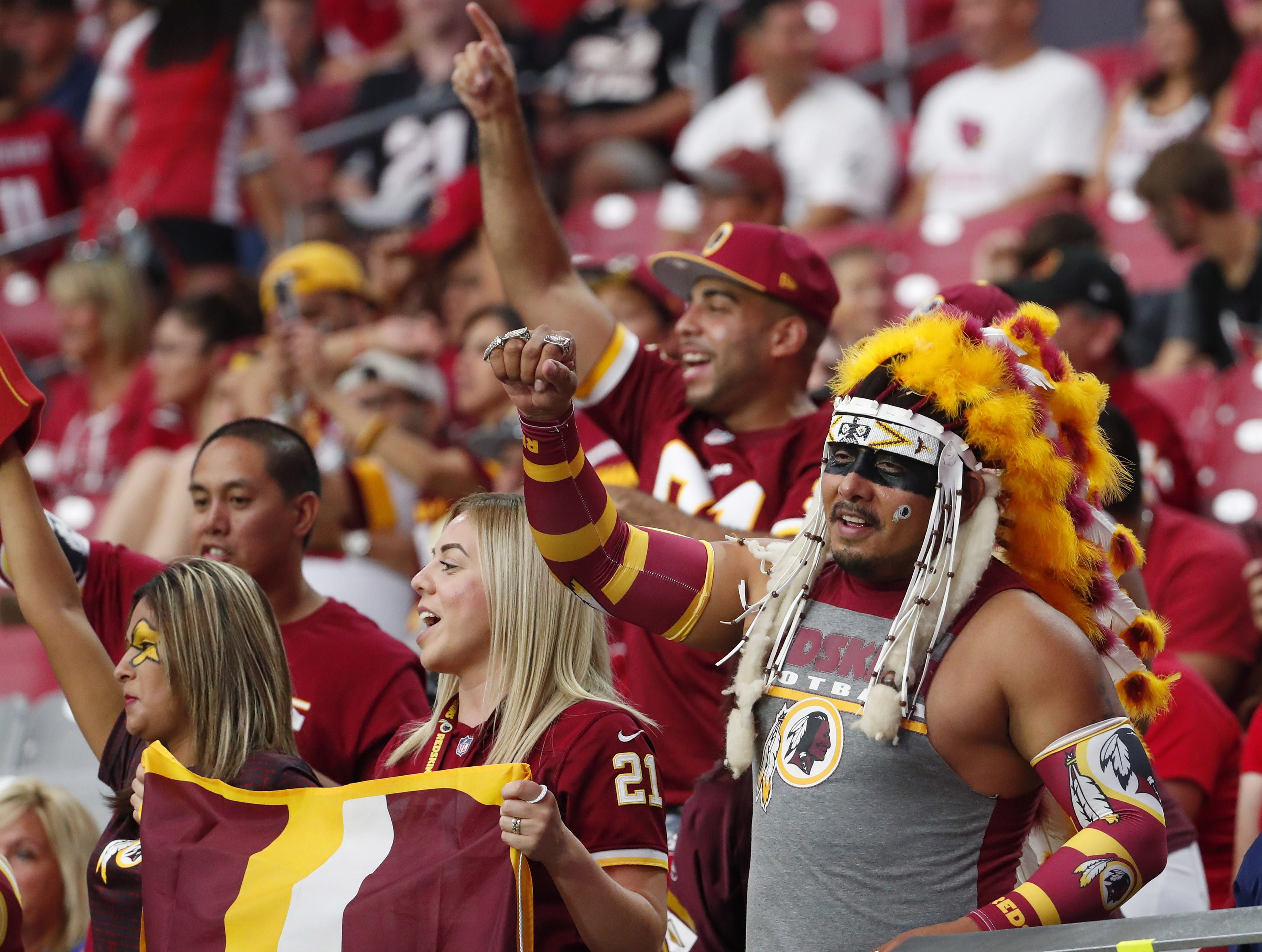 Washington Redskins fans cheer during their 24-6 victory against the Arizona Cardinals at State Farm Stadium in Glendale, Ariz. September 9. 2018.