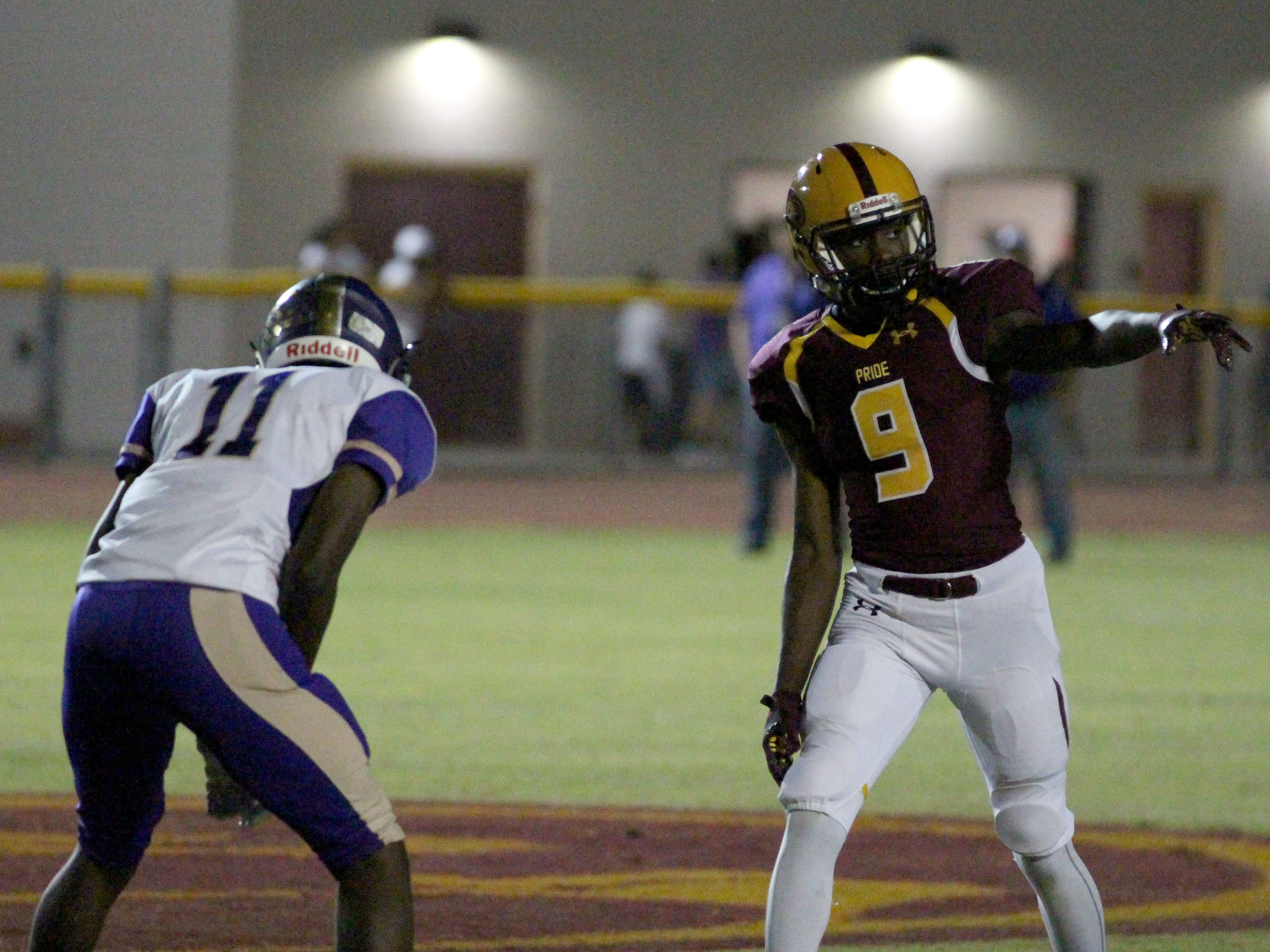 Mountain Pointe's Dominique Davis points to the referee during the game against Queen Creek on Friday night at Mountain Pointe High School on Sept. 21, 2018.