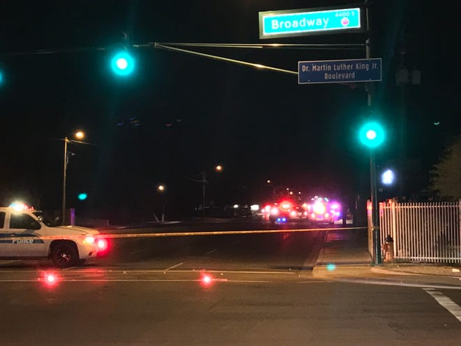 Phoenix police block traffic near 16th Street and Broadway road after a hit-and-run accident that killed a woman and left a child critically injured Friday night.
