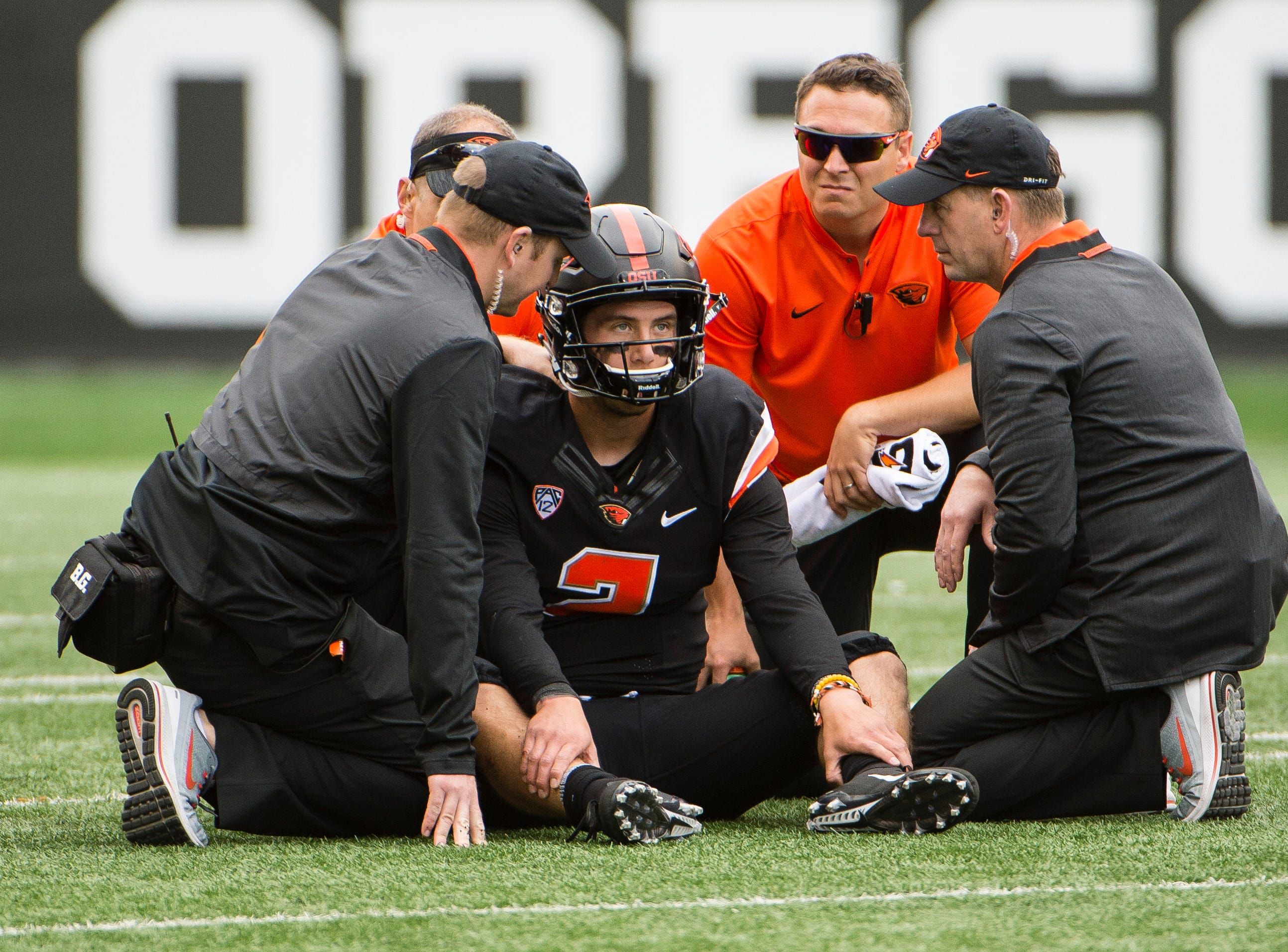 Sep 22, 2018; Corvallis, OR, USA; Oregon State Beavers quarterback Conor Blount (2) is looked after by trainers after getting sacked during the first half against the Arizona Wildcats at Reser Stadium.